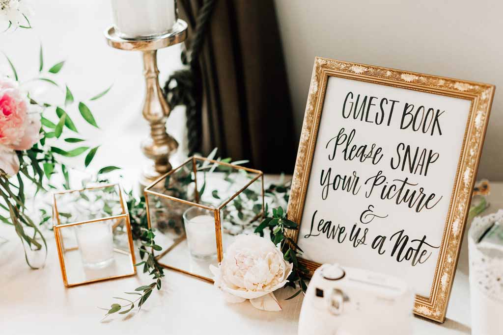 Custom wedding signage with gold geo terrarium, and gold candle