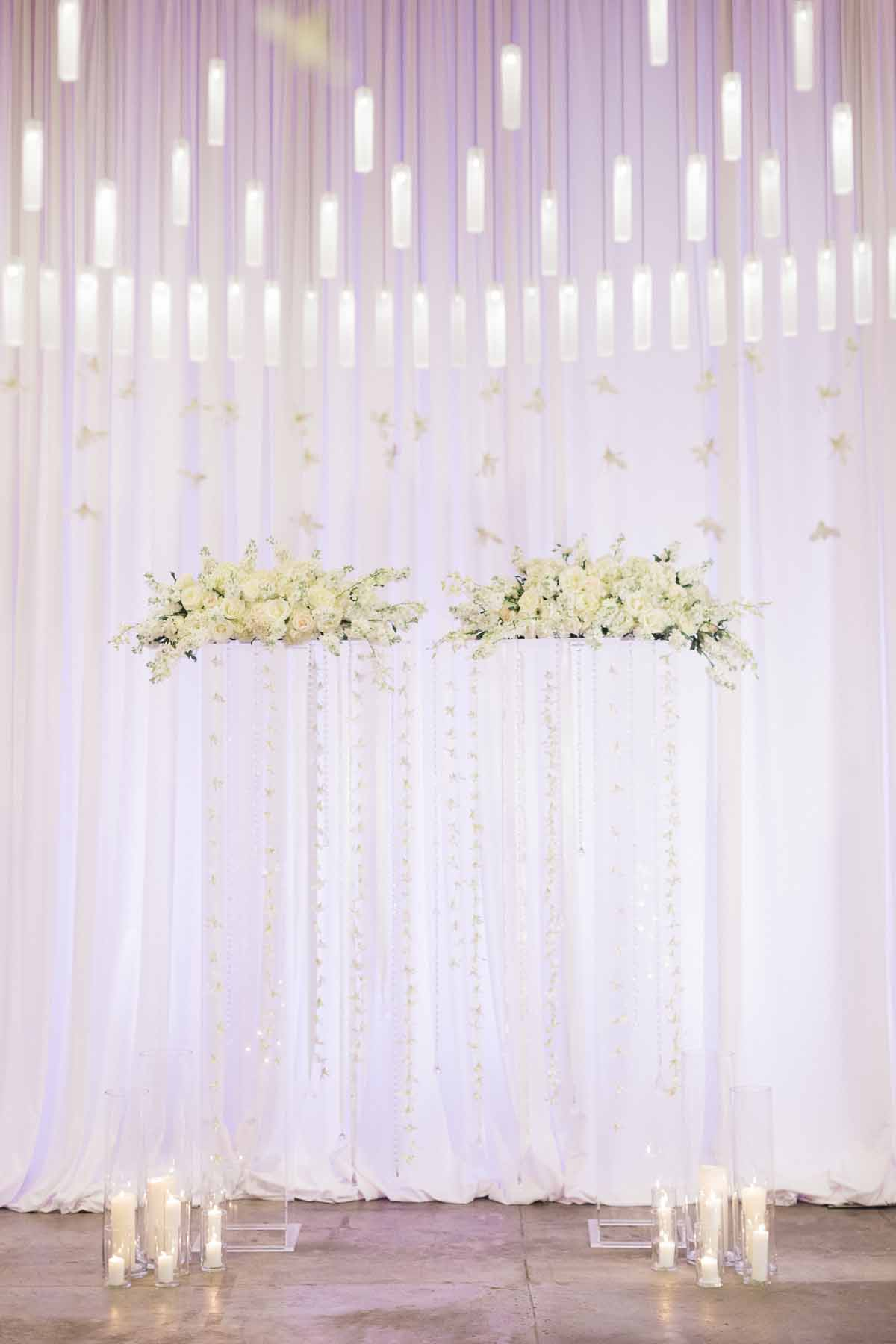 Ethereal wedding arch with clear lucite pillars