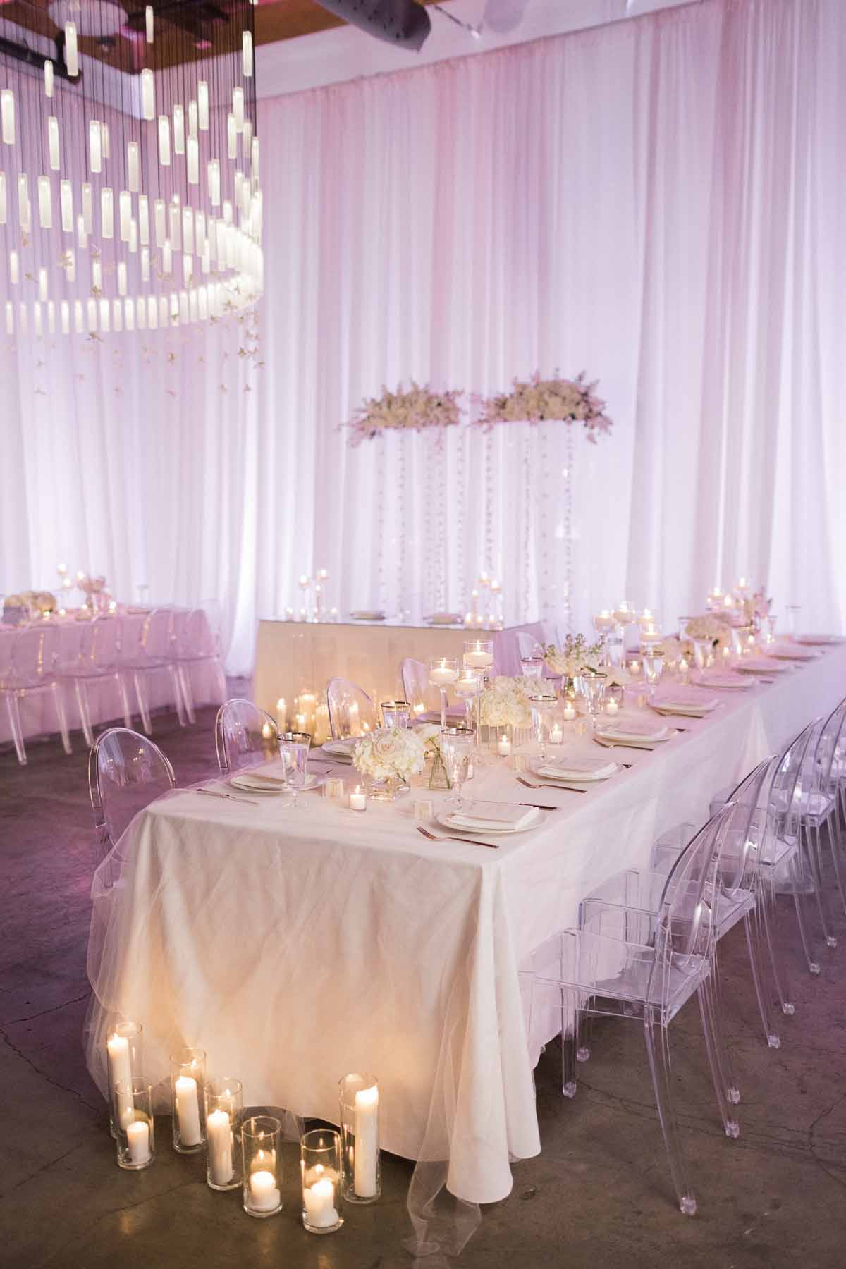 Long reception tables at modern white wedding at Canvas Event Space in Seattle