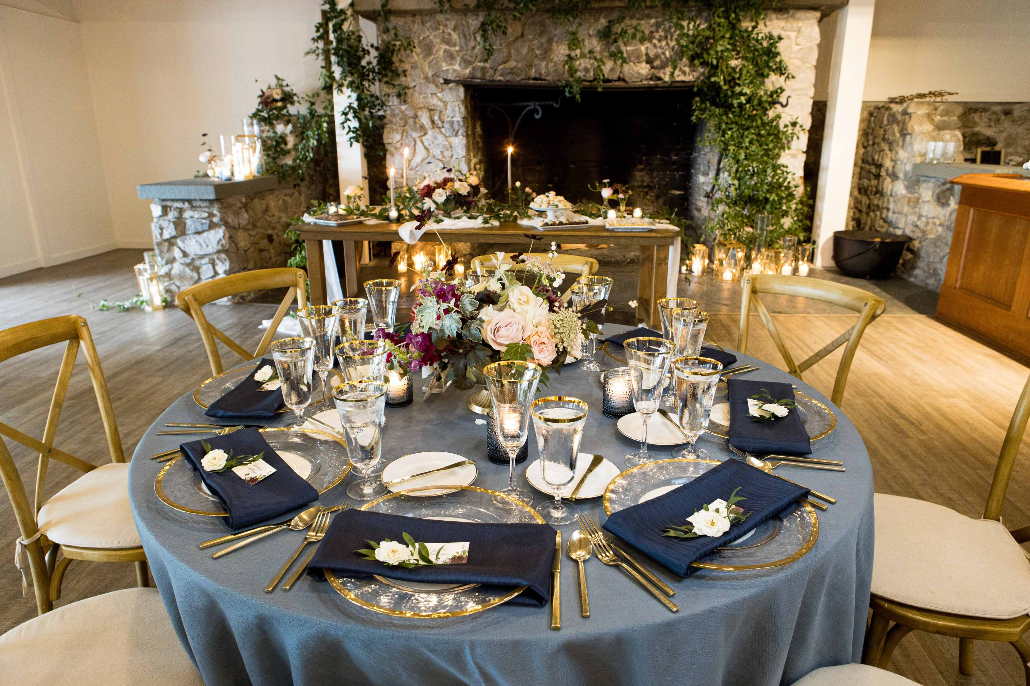 Wedding table at Roche Harbor Resort wedding with French blu linen and navy napkins