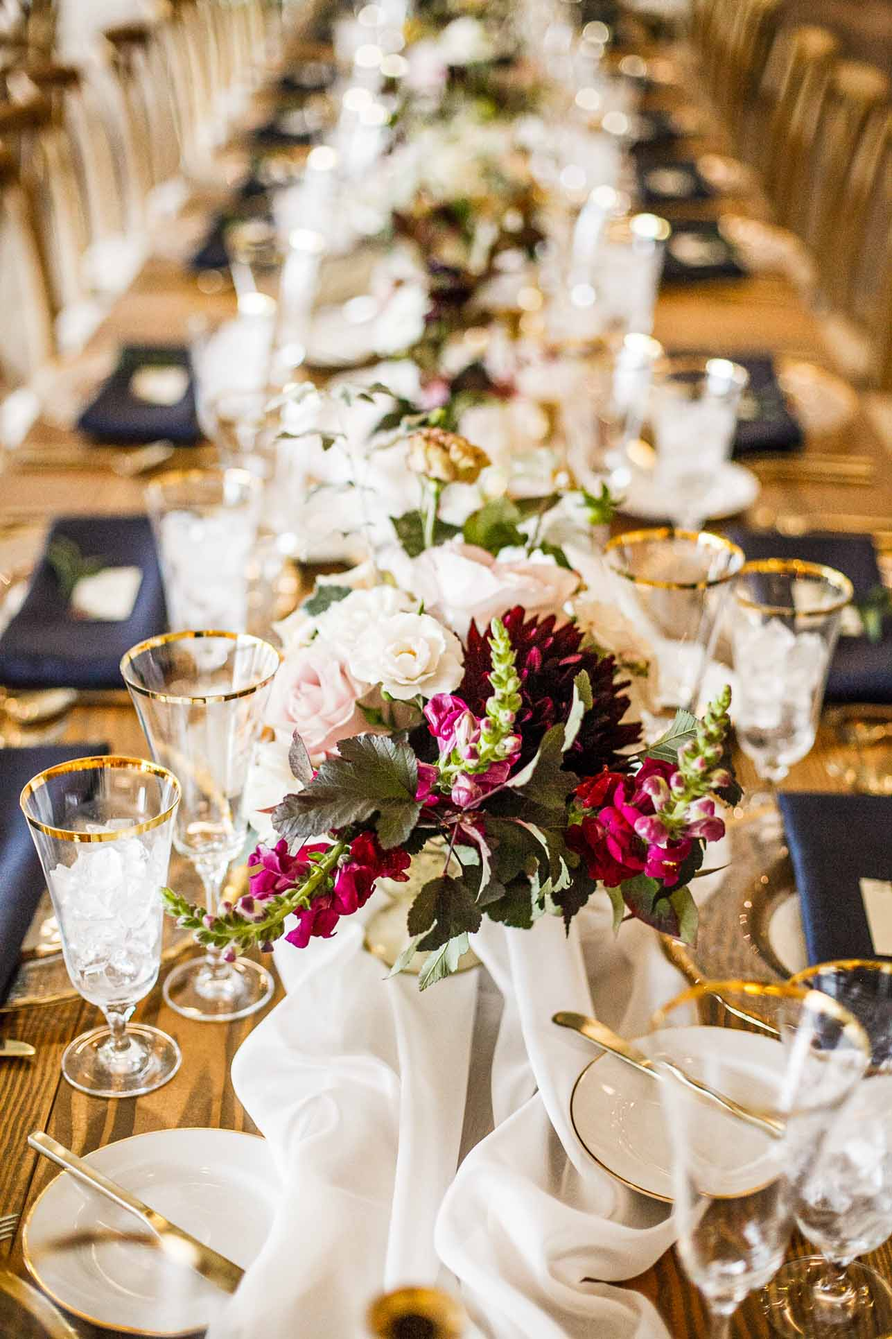 A long table decorated with pretty fall flowers