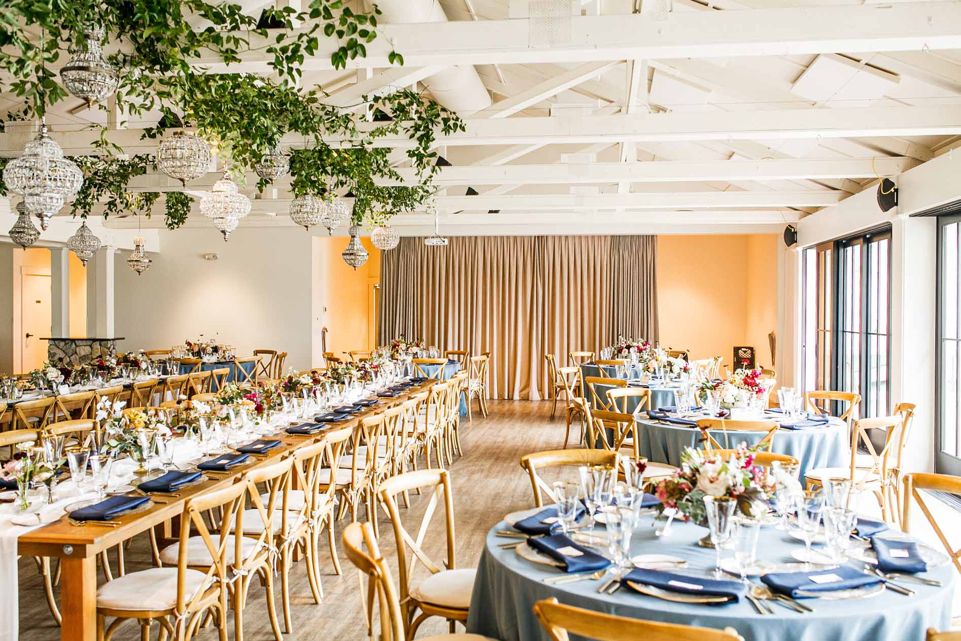 Wedding reception at Roche Harbor ballroom with French blue linens and Vineyard chairs