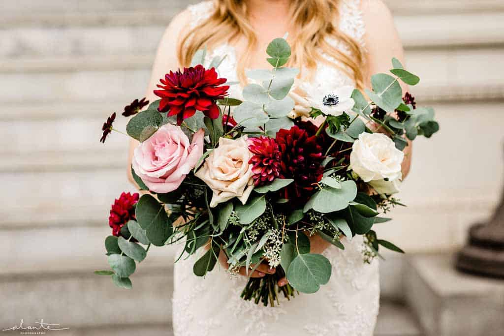 Bridal bouquet with burgundy dahlias, panda anemones, and blush roses