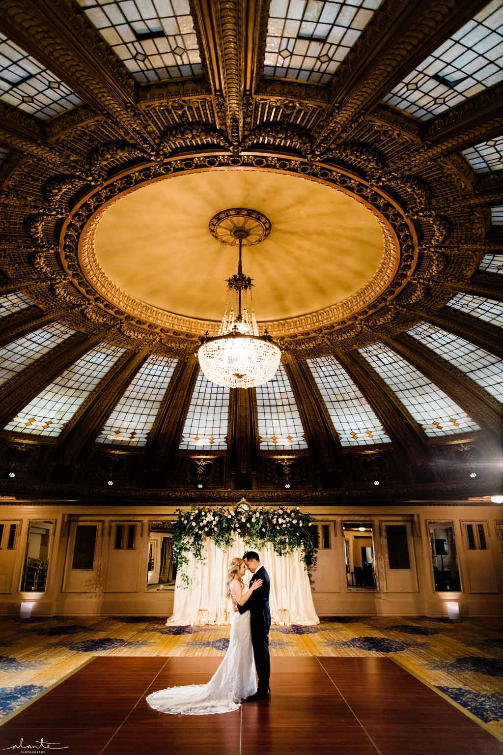 Bride and Groom under the domed ceiling at the Arctic Club Seattle