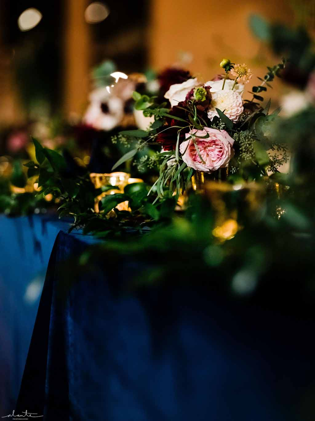 Burgundy, blush, and navy blue wedding reception