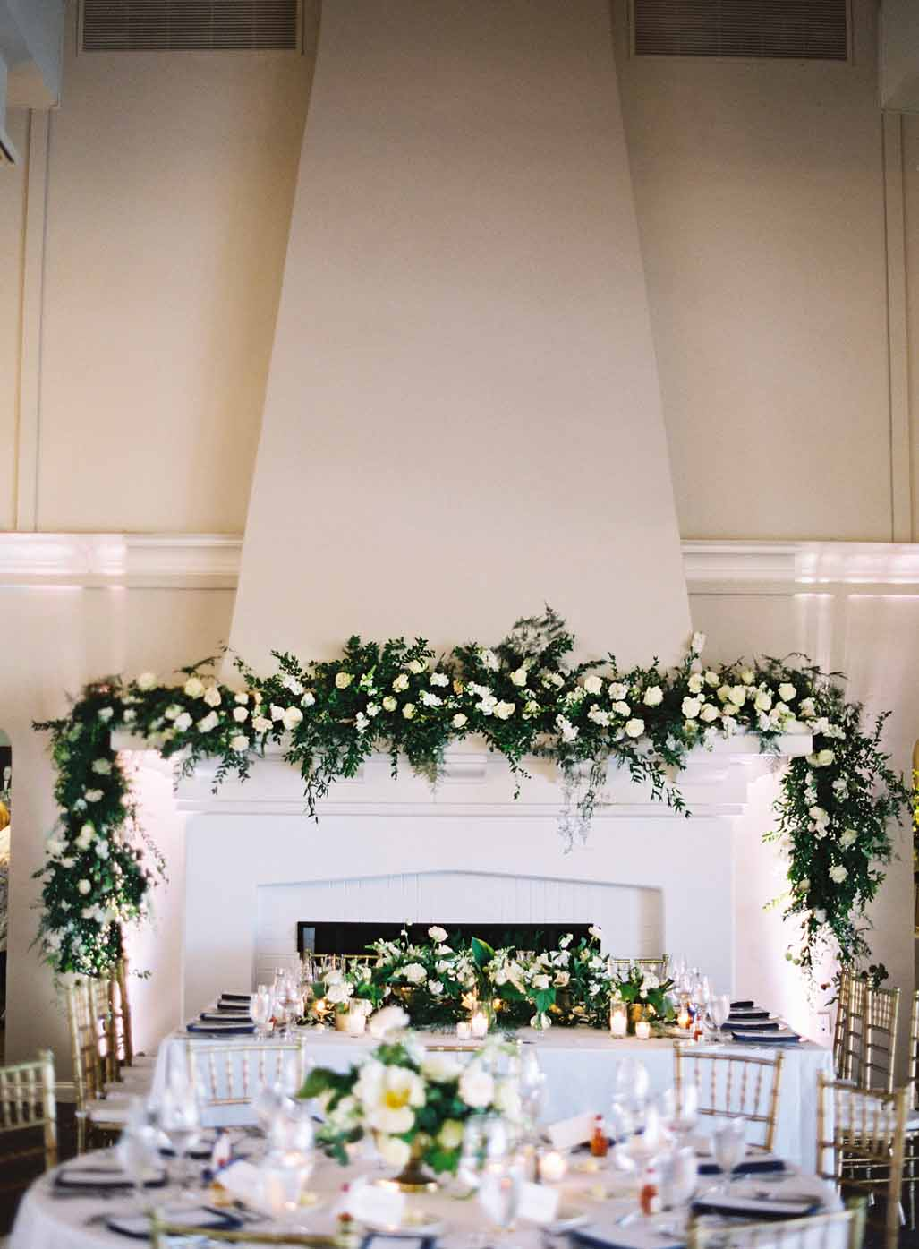 large greenery and floral garland as head table backdrop