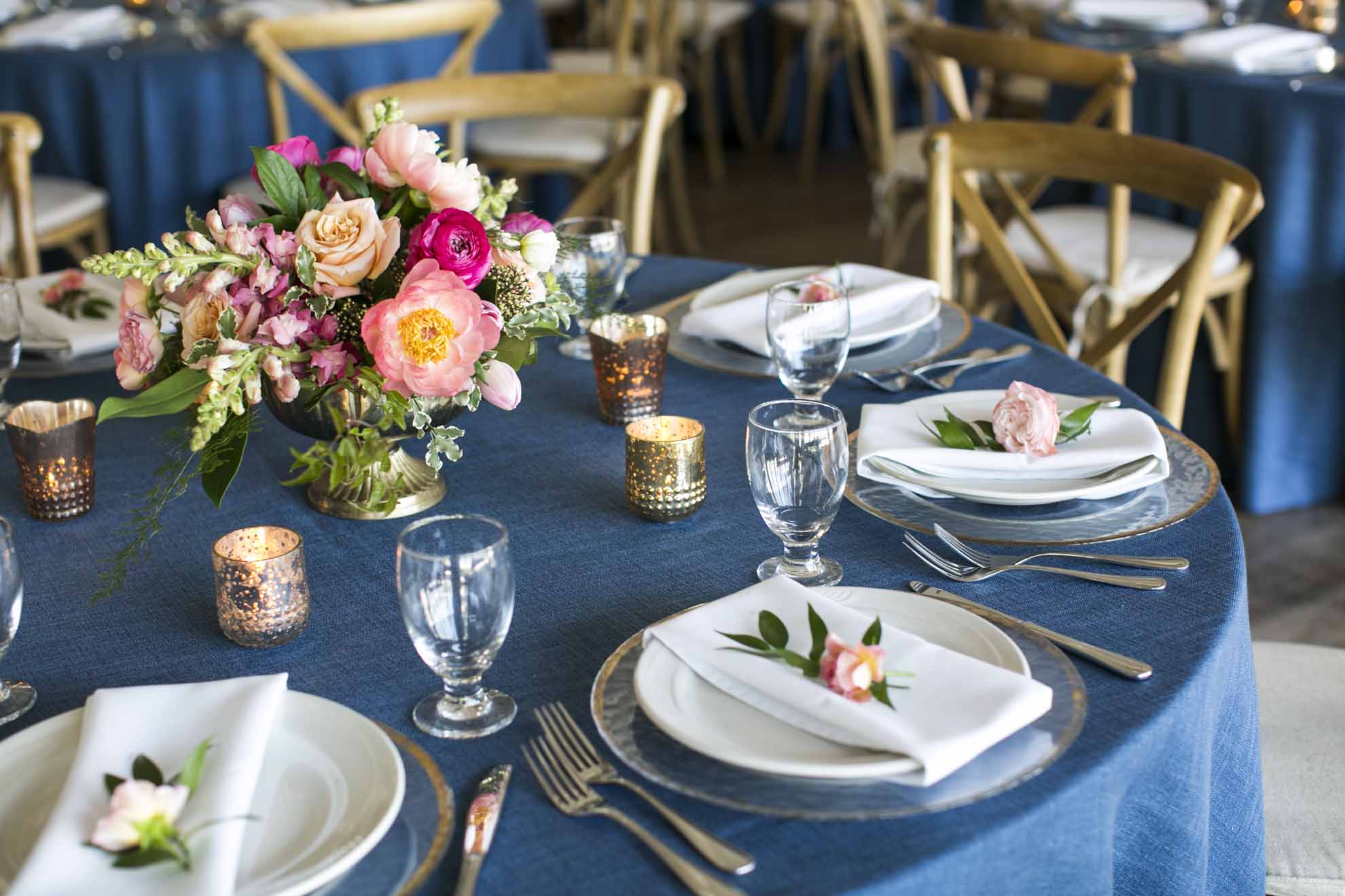Hot pink and blue wedding reception featuring pink compote centerpiece on blue linen - v