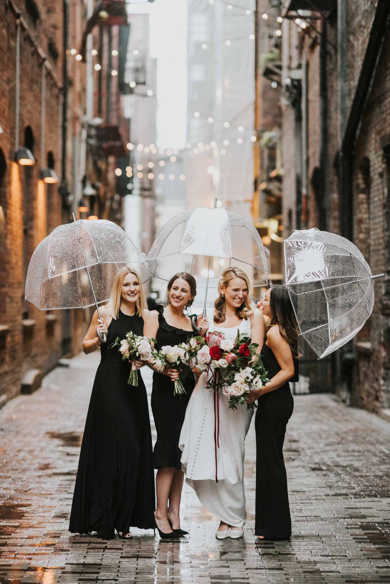 bride and bridesmaids in brick alley