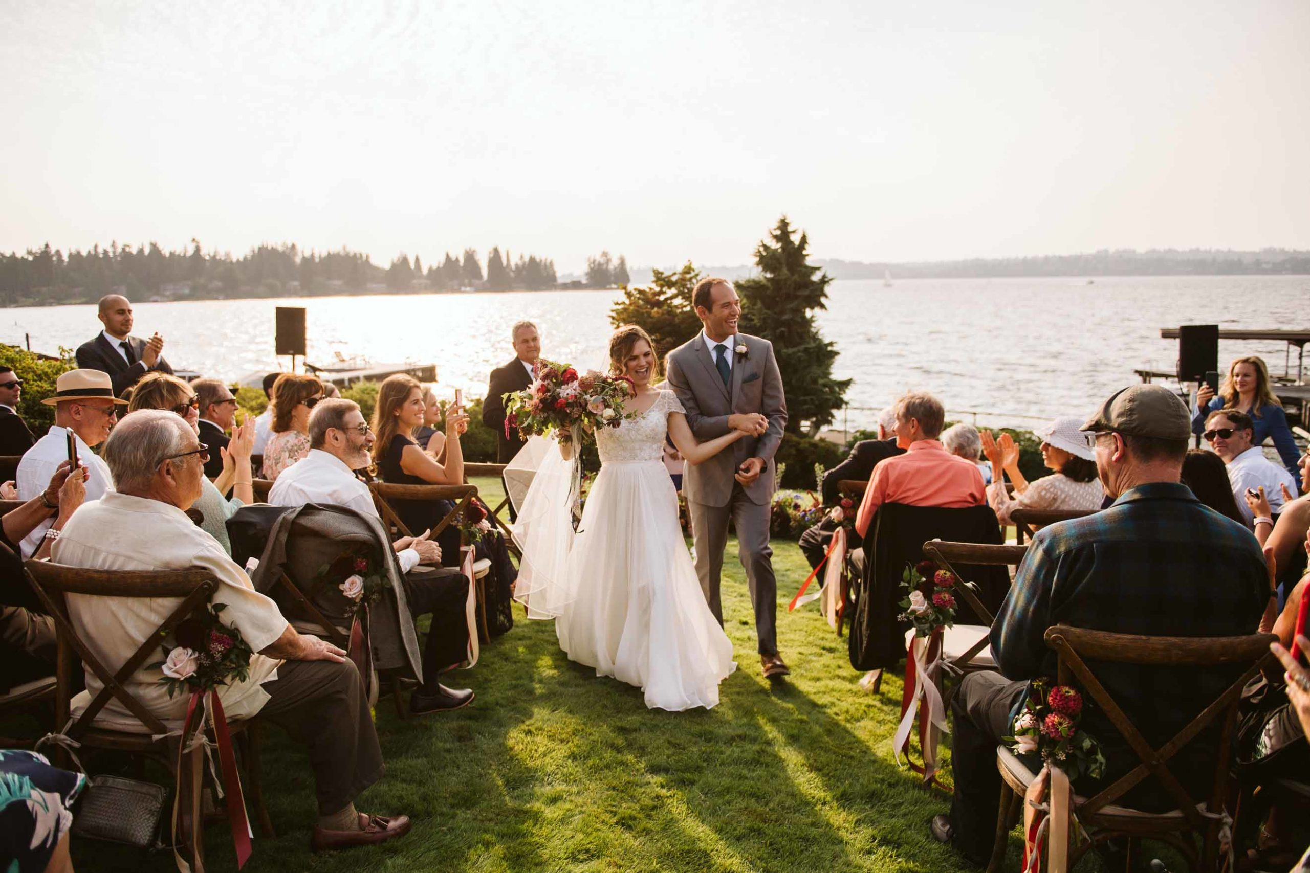 Bride and groom walking down the aisle of their outdoor intimate wedding ceremony on Lake Washington.