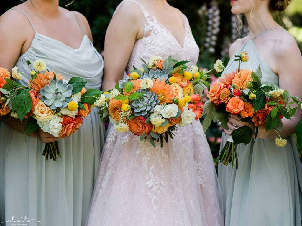Orange summer wedding bouquets with succulents and roses | Flora Nova Design Seattle