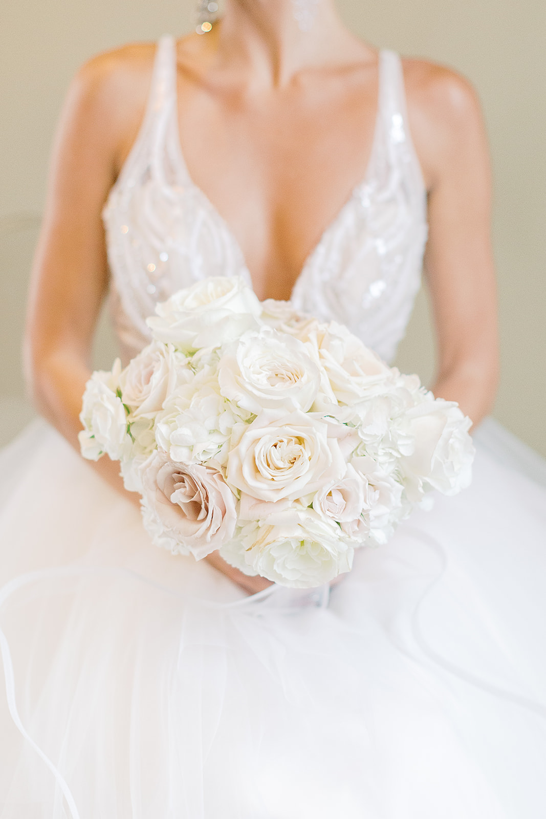 All white rose bridal bouquet for a formal ballroom summer white orchid wedding by Flora Nova Design Seattle