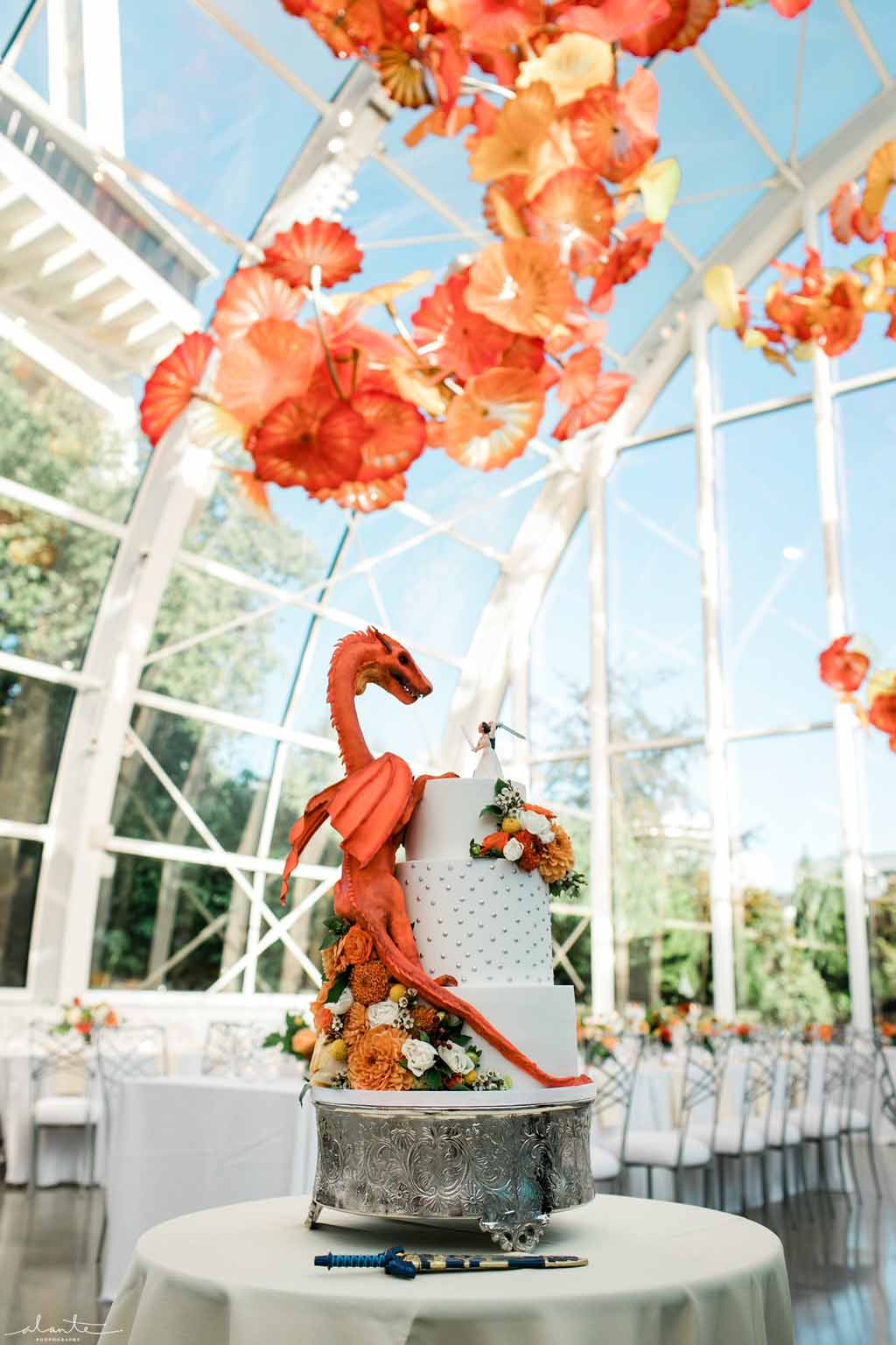 Orange dragon fantasy wedding cake with peach and orange flowers at Chihuly Glass House | Flora Nova Design Seattle