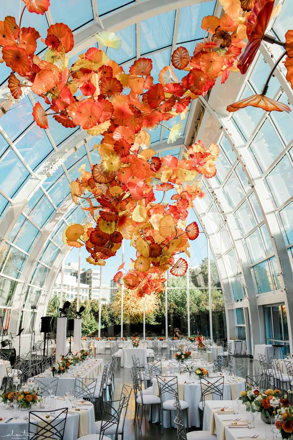 Vibrant orange wedding reception at Chihuly Gardens and Glass Seattle