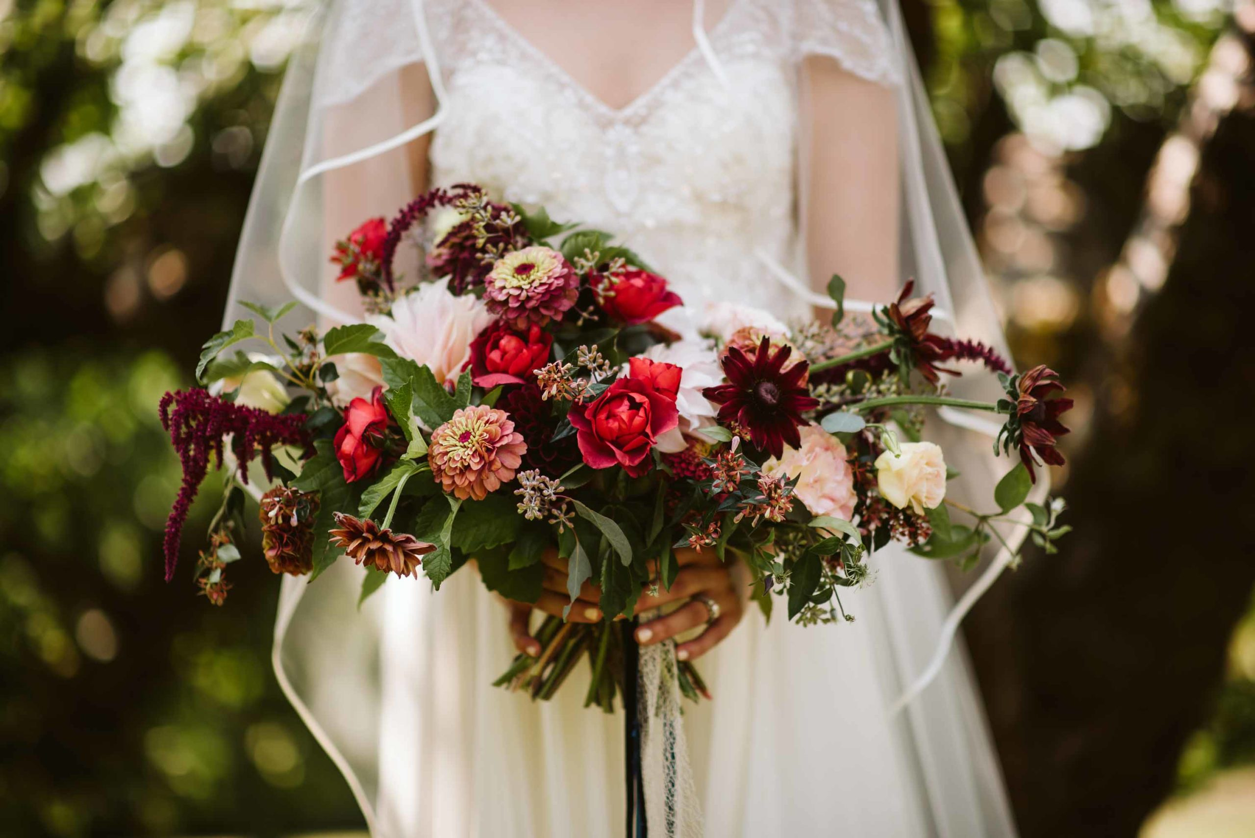 Red, rust, blush and green summer garden bridal bouquet with zinnias and roses. | Flora Nova Design Seattle