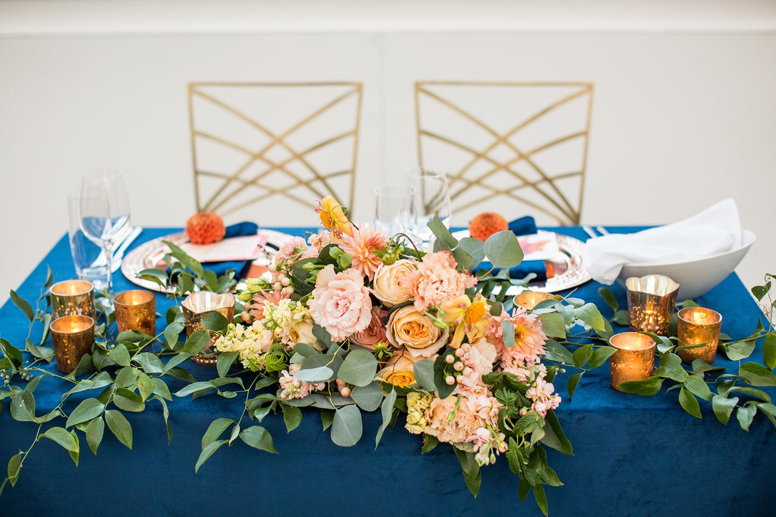 Low floral centerpiece with local dahlias, roses and eucalyptus on navy velvet linens for a fall wedding reception | Flora Nova Design Seattle