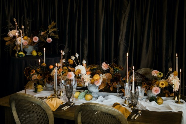 Beautiful Thanksgiving table with fresh floral centerpieces, wooden table, Provence chairs, taper candles, specialty linens, brown draping - Decorating for the Holidays - FLORA NOVA DESIGN SEATTLE