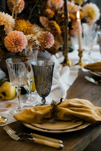 Thanksgiving table details with brown water glass, yellow velvet napkin