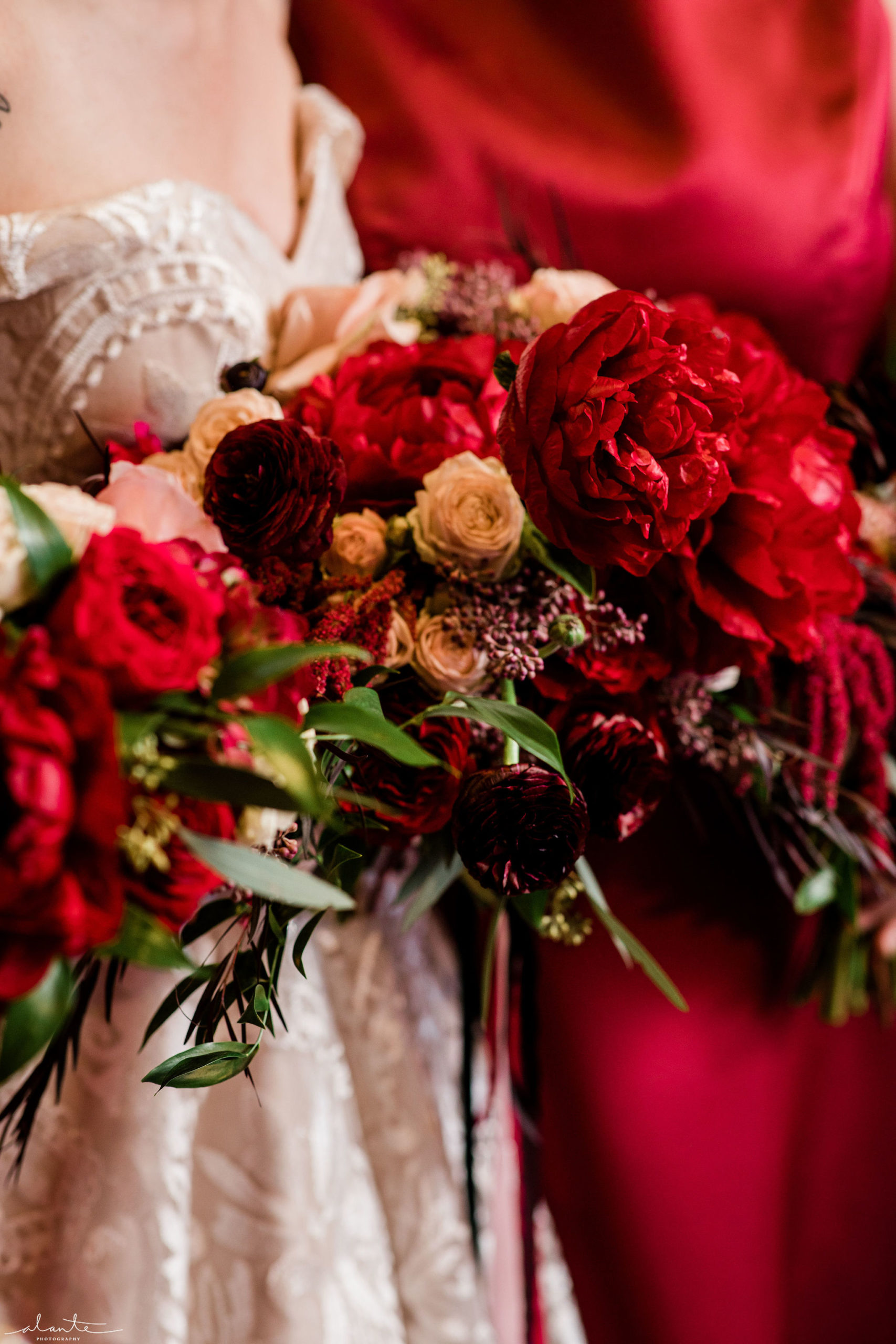 Red peonies are the star of these winter bouquets along with roses and foliages.