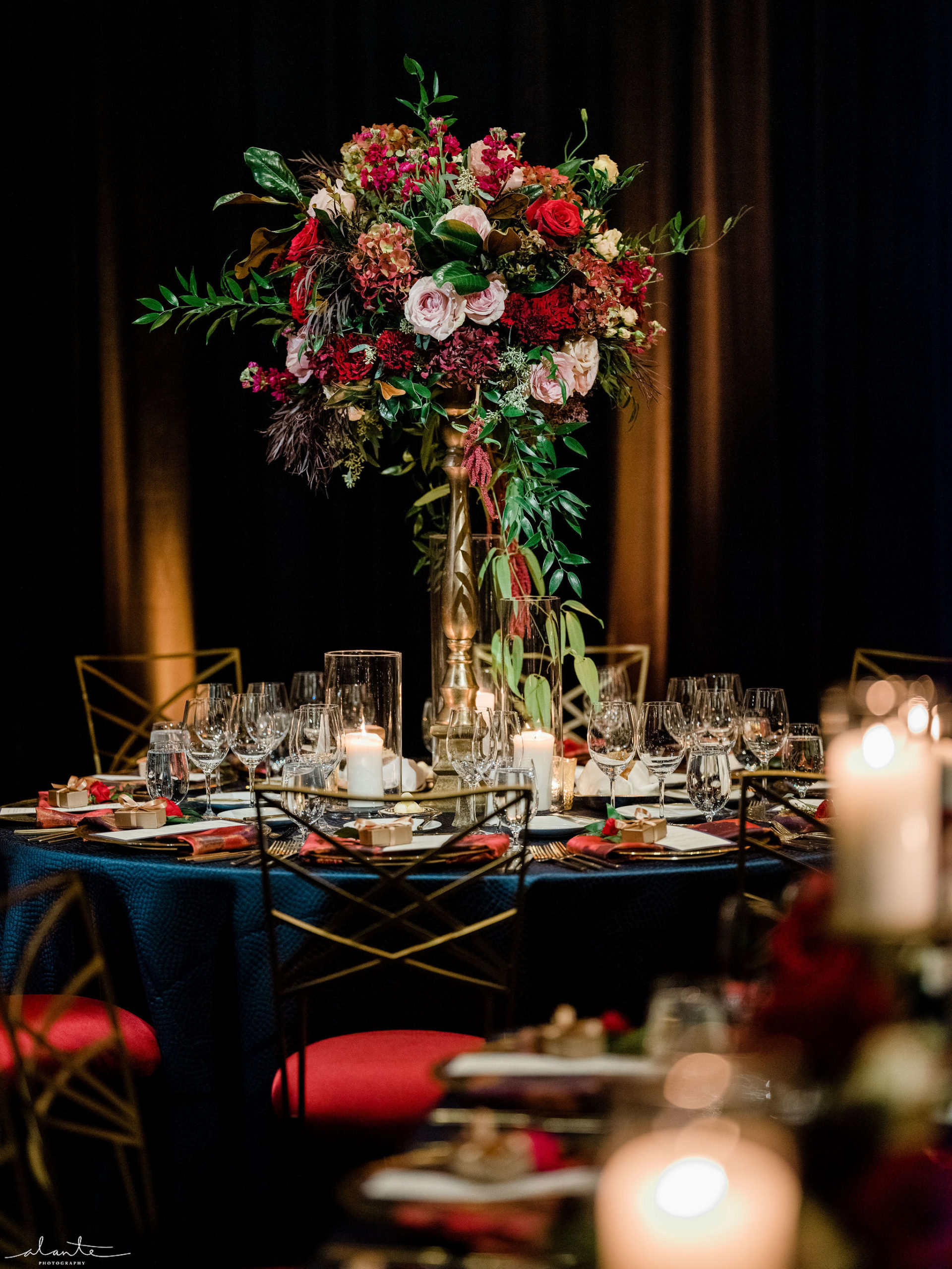 Elevated floral centerpiece in red and blush for a winter wedding reception | Designed by Flora Nova Design Seattle