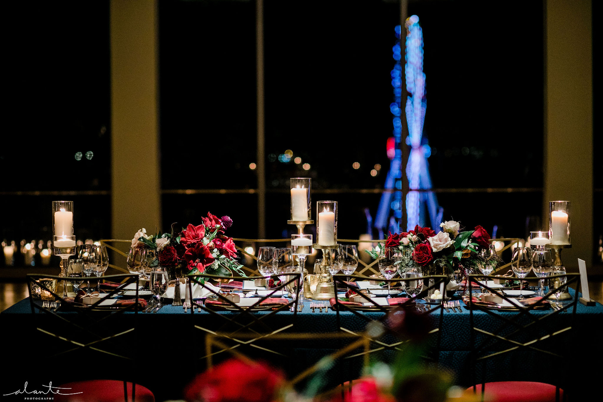 Red winter wedding reception at the Four Seasons Seattle with a view of the great Farris wheel out the ballroom windows.
