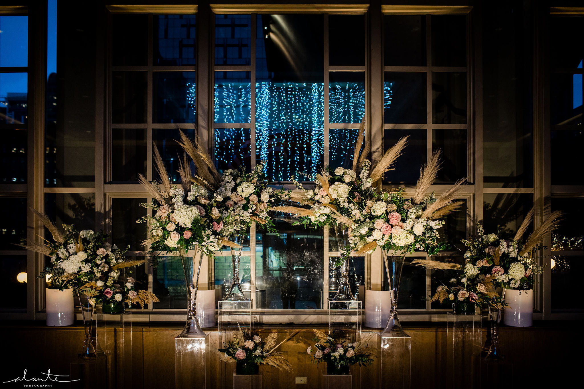 New Years Eve wedding ceremony alter floral arrangements featuring pampas grasses and white and blush flowers | Flora Nova Design