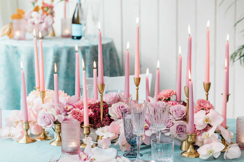 Phalaenopsis orchids, cymbidium orchids, roses, spray roses, and carnations all in the pink and mauve color palette make up this lush floral centerpiece.