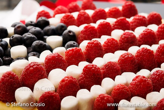Patriotic cheesecake with raspberries, blueberries and mini marshmallows