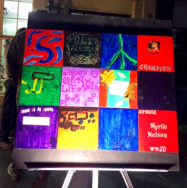 """Kimberly Bourque, a Master of Occupational Therapy student at Bay Path University, exhibited """"Resiliency – A Local Peace Art Tile Project"""" created by 12 brain injury patients from the Enrichment Center."""