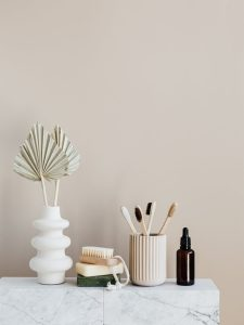 set of natural toiletries on marble table in bathroom