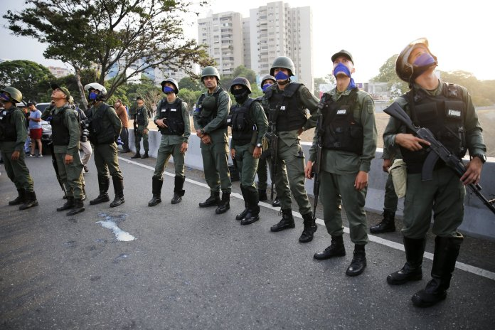 Uprising soldiers stands outside La Carlota air base in Caracas, Venezuela