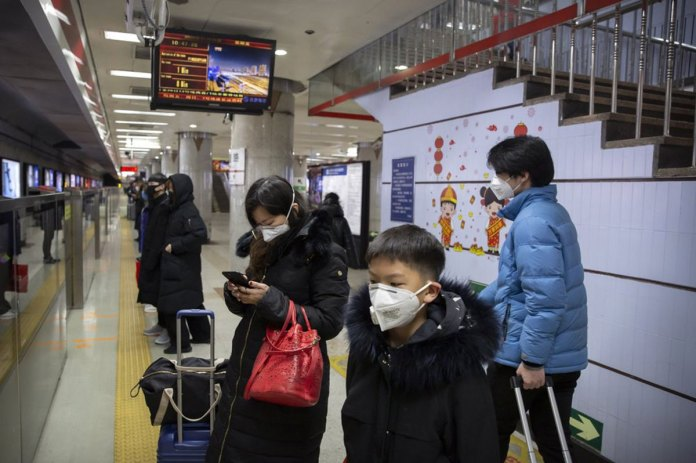 China Building a Hospital to Treat Virus, Expands Lockdowns