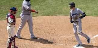 Marlins top Phillies 11-6 as specter of coronavirus looms