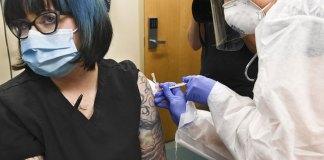 Virus vaccine put to final test in thousands of volunteers
