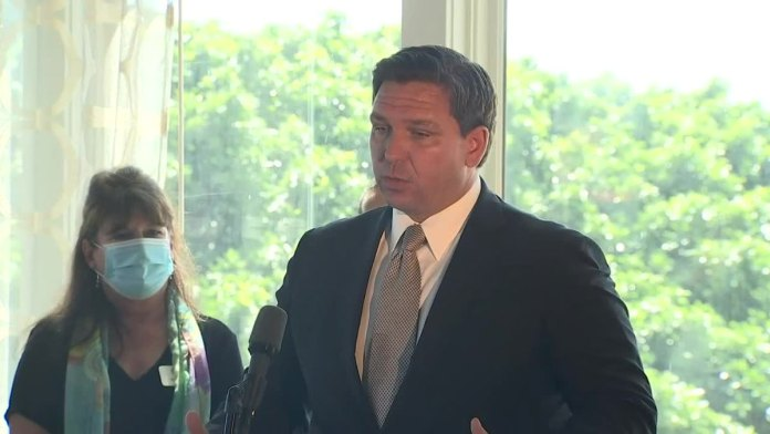 Florida governor reopening state's economy despite spread