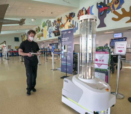 Virus-killing robots move from hospitals to public spaces