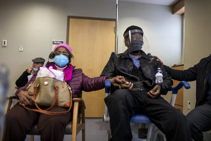 Virus numbers drop, but race against new strains heats up
