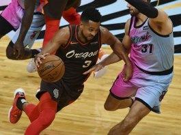 McCollum, Blazers hold off short-handed Heat, 125-122