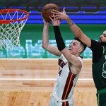 Heat clinch playoff spot with 129-121 victory over Celtics