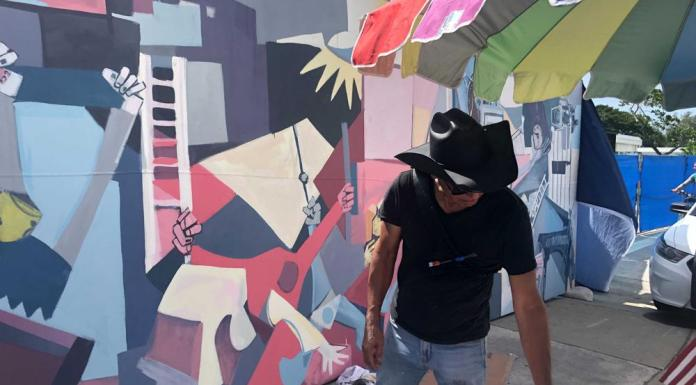 Artist uses his brush to turn Surfside's pain into hope