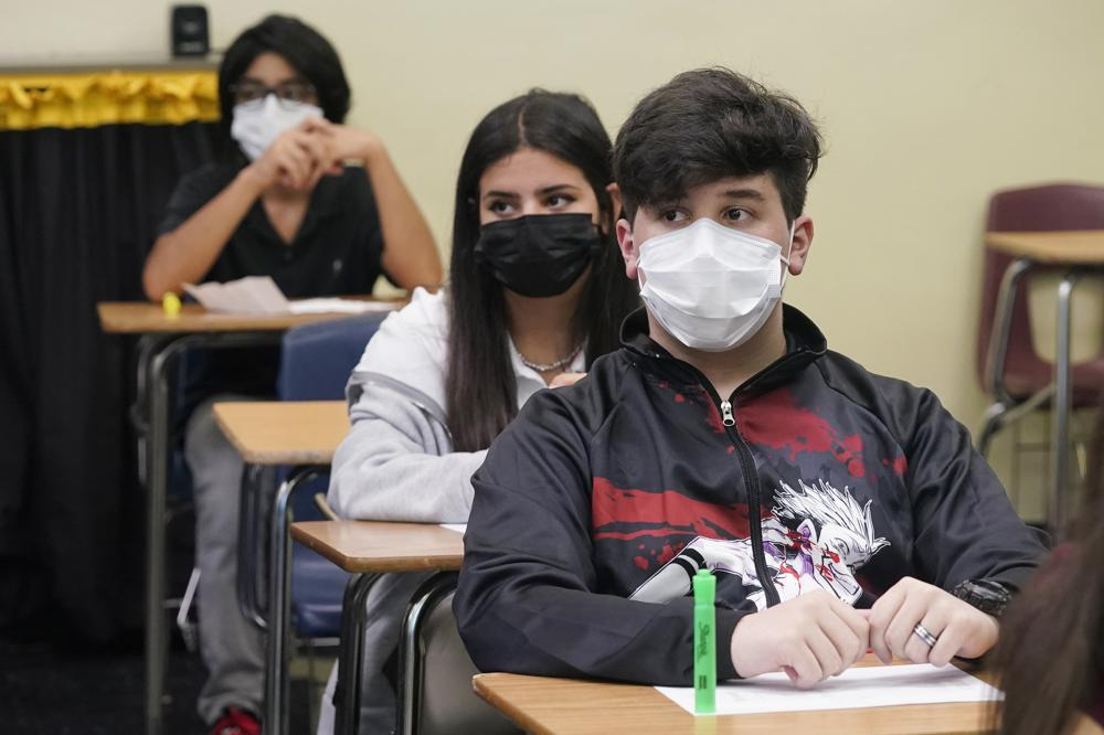Officials withhold school board salaries over mask manda