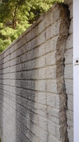 loseup of cracked retaining wall
