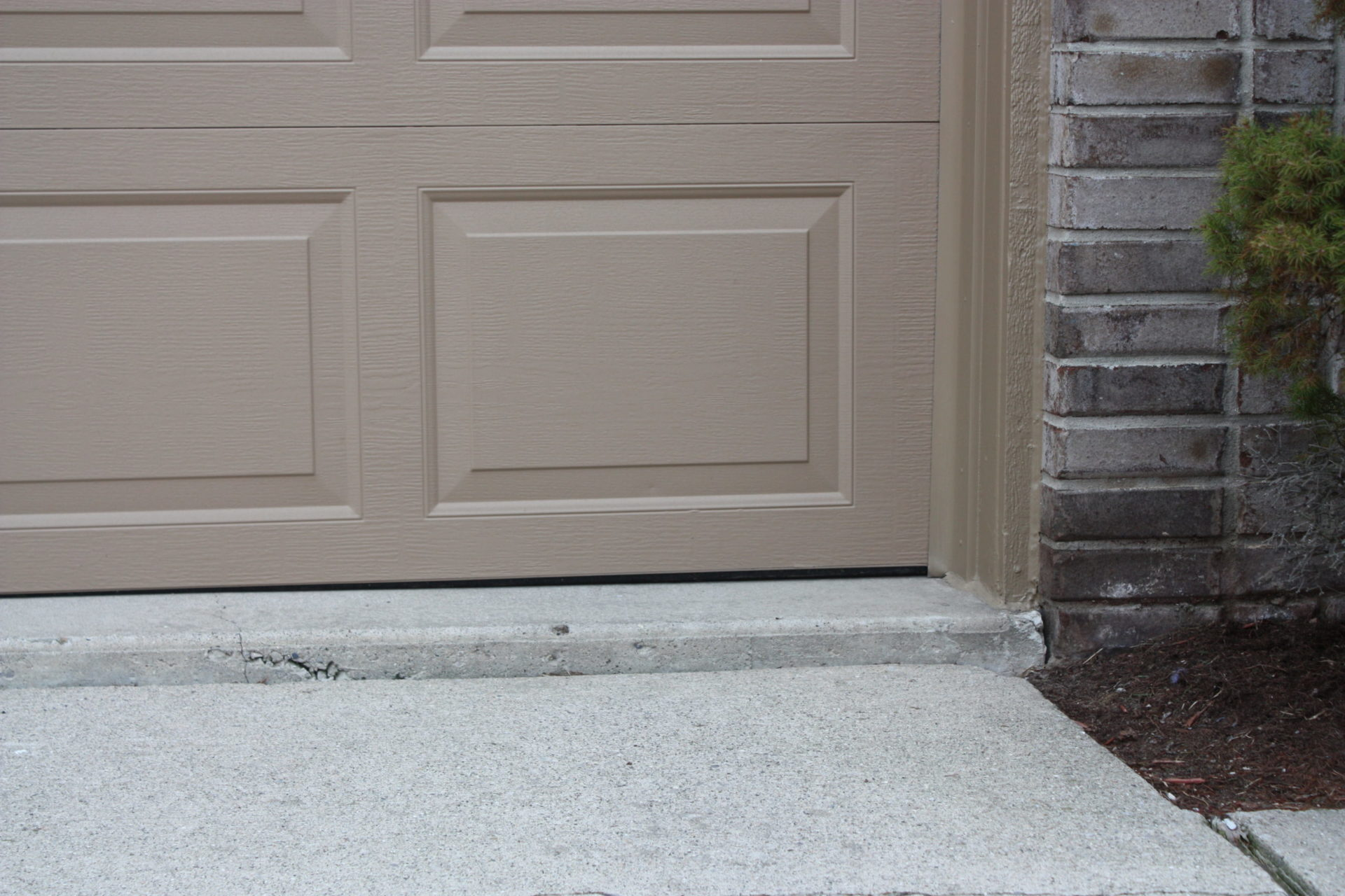 Concrete driveway sinking - before