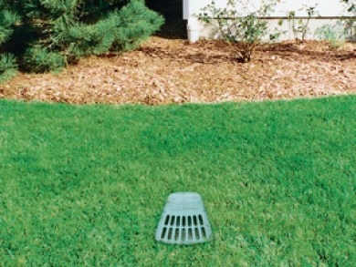 A buried gutter drain downspout extension installed in Deltona