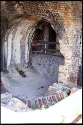 The difficulty of building on sand provided a challenge for the military engineers who were attempting to build Fort Pickens. One feature designed to prevent it from sinking into the sand was the use of a reverse arch as the foundation for the walls of the casemates. This view shows a reverse arch, which has been excavated to illustrate this structure.