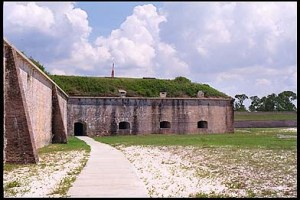 The bastions are structures which extend into the ditch, allowing guns to fire at an enemy who is trying to scale the walls of the fort. Again, the gun embrasures you see were originally several feet higher above the ditch than at present, making them much more difficult for an enemy to attack.