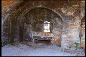 A gun casemate, along the seaward wall of the fort. Note the slots under the gunport to allow attachment of the gun carriage.