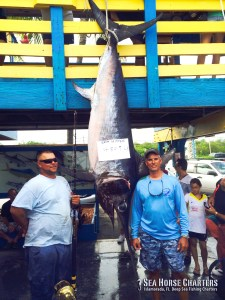 Capt. Rick (right) with a monster 480.9 lb. swordfish caught on THE SEA HORSE.