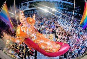 "Female impersonator Gary Marion, as ""Sushi,"" dangles above New Year's Eve revellers in a giant replica of a woman's high heel at the Bourbon Street Pub complex in Key West, Florida, December 31, 2011. The Red Shoe Drop is a Key West tradition to celebrate the arrival of the new year. REUTERS/Andy Newman/Florida Keys News Bureau/Handout (UNITED STATES - Tags: SOCIETY ENTERTAINMENT TPX IMAGES OF THE DAY) FOR EDITORIAL USE ONLY. NOT FOR SALE FOR MARKETING OR ADVERTISING CAMPAIGNS. THIS IMAGE HAS BEEN SUPPLIED BY A THIRD PARTY. IT IS DISTRIBUTED, EXACTLY AS RECEIVED BY REUTERS, AS A SERVICE TO CLIENTS ORG XMIT: KWP06"