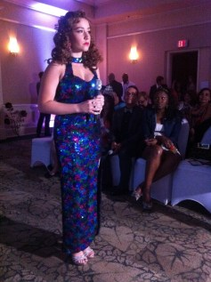 """Actress, model, and singer Sarah Caroline prepares to sing """"You Are Beautiful"""" during the Jarix Fashion Show. Source: Mellissa Thomas."""