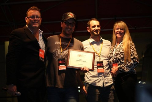"""Concealed"" director and producer Shane T. Hall (2nd left) and producer Lyall Sumner receive the Best Cinematography award at the OFFX Award Ceremony Saturday. Photo: J. Willie David III/Florida National News."